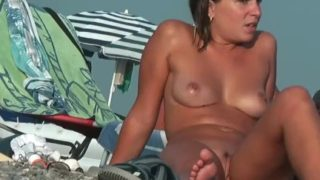 Nude beach voyeur spies on a  nudist